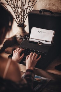 typist typing on an old typewriter - illustrating an article about My Favourite Creative Writers Resources