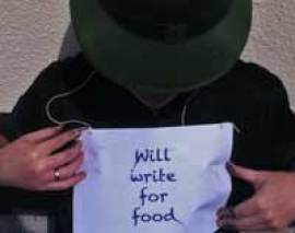 man with sign will write for food illustrating an article on building a website