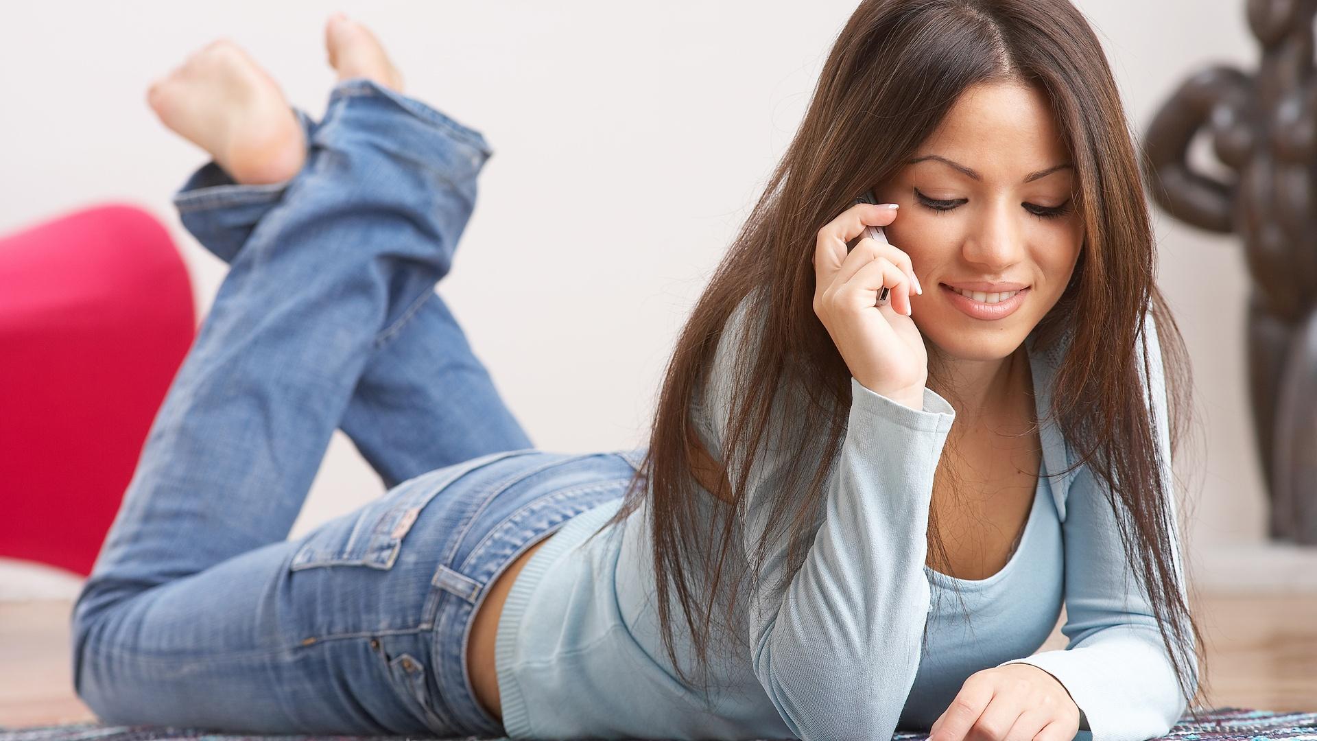Horny lesbian women are sharing a long dildo