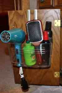 over the cabinet door hair dryer and product holder