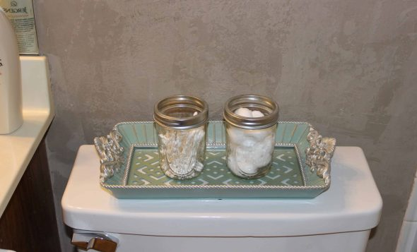 mason jars on fancy tray to hold cotton swabs an cotton balls