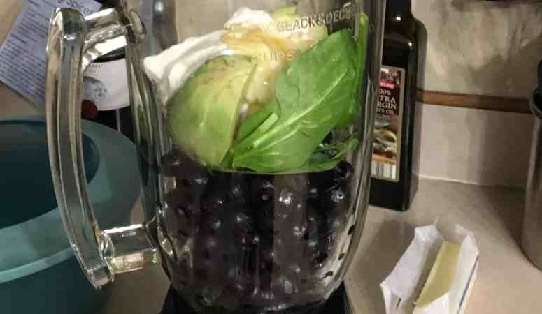 Creamy blueberry smoothie ingredients in the blender