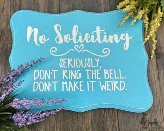 No Soliciting sign. No Soliciting. Seriously, don't ring the bell. Don't make it weird.