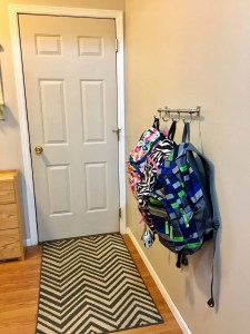 Place a hook rail for backpacks low enough for kids to reach by the door they use. A back to school routine should be simple so that it alleviates stress instead of adding more!Here are four routine ideas that will work for any family.~Practigal Blog