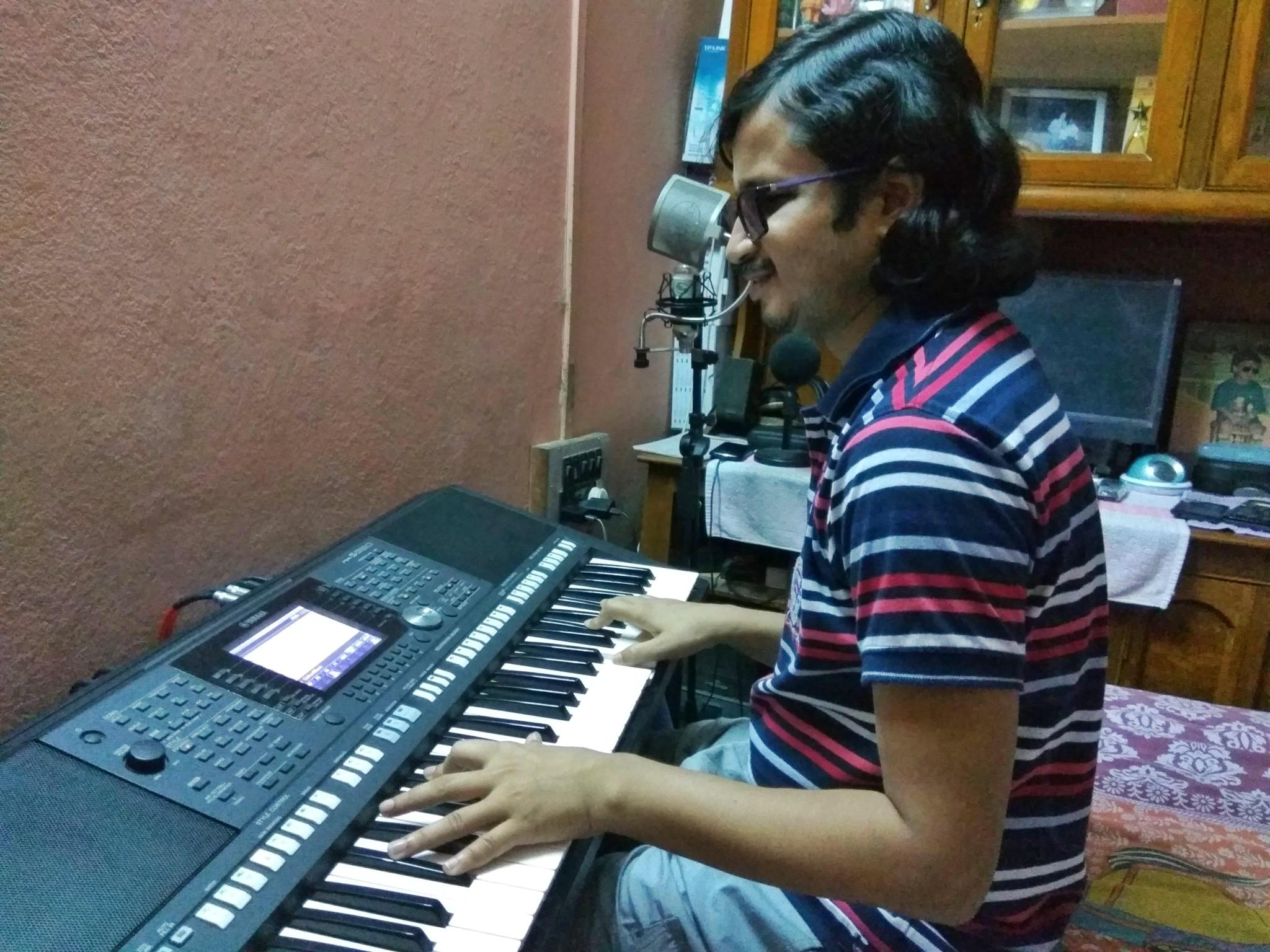 Pradip is recording keyboard in Bedroom Studio