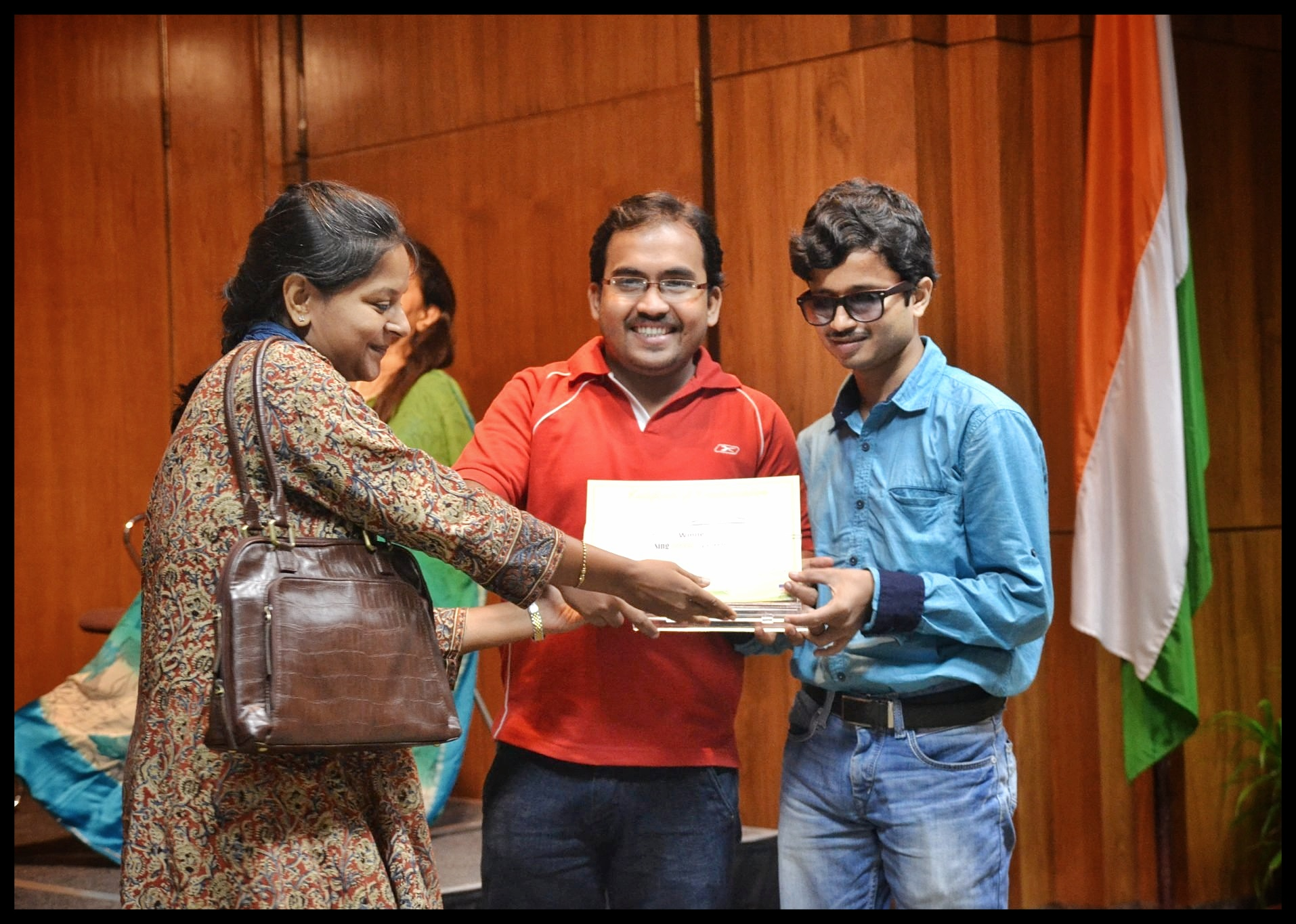 Pradip is taking the Sing Green Award with Pinaki