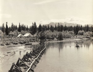 "The Bristol Bay Investigation's temporary tent camp and fish weir established at the outlet of the Brooks River in 1940.  Photographed by Robert Hacker.  ""Brooks Camp Interpretive Collection,"" KATM Photo Archives, Records of Katmai National Park and Preserve, Anchorage, Alaska."