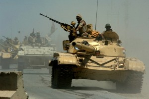060518-N-6901L-022 (May 18, 2006) Mushahda, Iraq.Iraqi tanks from the Iraqi Army 9th Mechanized Division pass through a highway checkpoint on their way to Forward Operating Base Camp Taji, Iraq..U.S. Navy photo by Photographer's Mate 1st Class Michael Larson. (RELEASED)