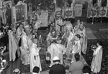 St. John (center) serving the Divine Liturgy at the Convent of the Vladimir Icon of the Theotokos in San Francisco. Concelebrating with him are Bishop Nektary of Seattle (left) and Bishop Sava of Edmonton (right). The author is next to Bishop Sava, holding the trikirion.