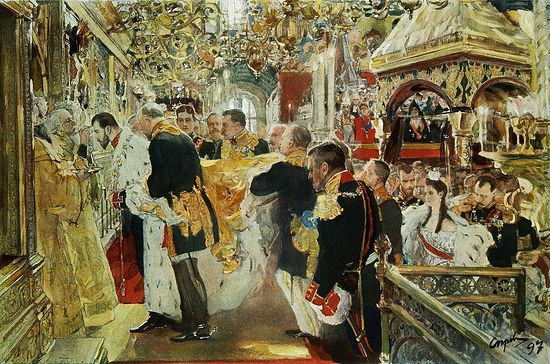 The anointing of Nicholas II, May 1896, Uspenskiy Sobor, with Empress Alexandra waiting behind him for her own anointing.