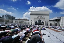 Some worshipers are prostrating during their prayer.