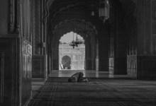 A muslim offer prostration during prayer.