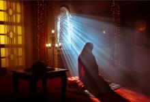 a woman offers prayer.