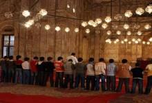 A group of Muslim children offer congregational prayer at a mosque - Standing Foot next to Foot in Prayer: Mandatory?
