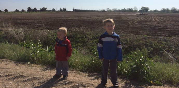 April 2016, watching a tractor plant the field.