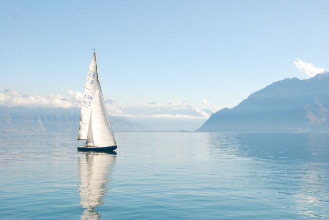 A visual of a boat in serene water to show God's help through the turbulent COVID season.