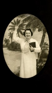 Woman with book and palm trees