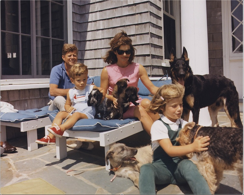 Kennedy and Jackie O on vacation with kids and puppies