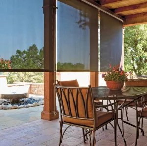 Solar patio shades in Denver helps to block the glare and the heat! This is showing a dark patio shade.