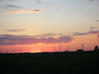 View of wind farm at sunset | Precision Filtration Products