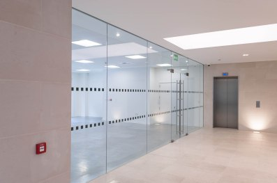 Glass partition with double doors
