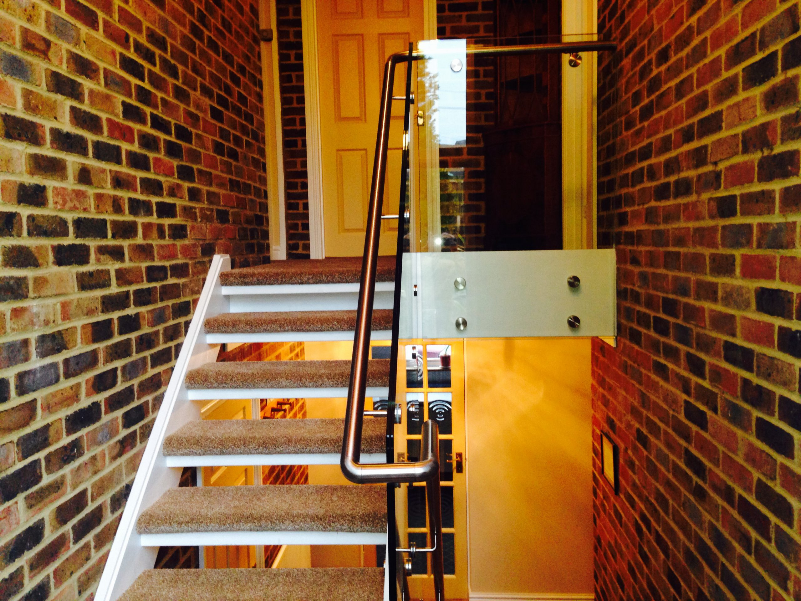 Glass Balustrade with brushed stainless handrail