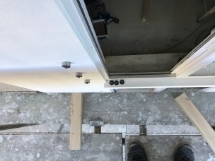 Juliette Balcony glazing bolts pre-installed prior to the render going in.