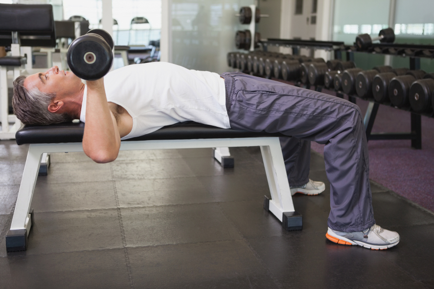 Fit-man-lifting-dumbbells-lying-on-the-bench-000053340814_Small