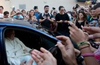 Large crowds gathered outside the shop as Pope Francis bought new glasses