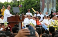 "President Benigno Simeon Aquino III addresses the re-enactment of the historic ""Salubungan"" in front of the People Power Monument during the commemorative activities of the 30th anniversary of the EDSA People Power Revolution in White Plains Avenue corner Epifanio de los Santos Avenue (EDSA) Thursday February 25, 2016. It re-enacts the stopping of the tanks and the convergence of the military and civilian contingents. This year's theme is ""EDSA 30 Pagbabago Ipinaglaban N'yo Itutuloy Ku!""..The 1986 peaceful and bloodless uprising ousted the dictatorship and catapulted the late Corazon C. Aquino to the Presidency. (Photo by: Joseph Vidal/ Malacañang Photo Bureau)."