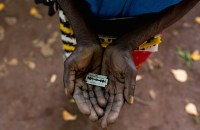 A woman in Mombasa, Kenya, shows the razorblade she uses to cut girls' genitals. Photograph: Ivan Lieman/Barcroft Media