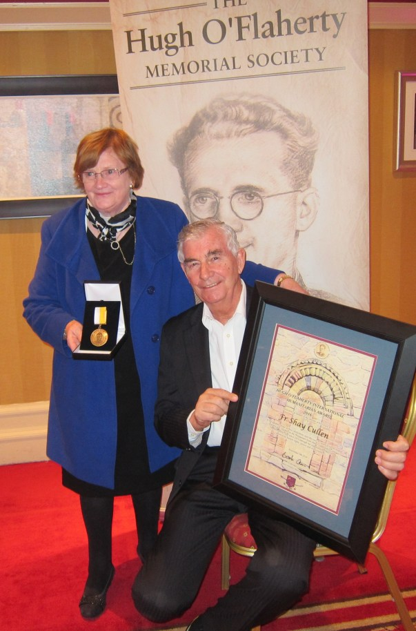 The grand niece of Mons.Hugh O'Flaherty presents the Mons.Hugh O'Flaherty International Humanitarian Award medal and plaque to Father Shay Cullen,of the Preda Foundation which he founded in 1974 to save women and children from jails, abusers and human traffickers. The award was presented in Killarney, Ireland on 5 November 2016