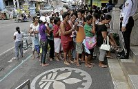 QUEUES by beneficiaries of the government's cash transfer program have become a familiar sight where the program is being implemented, like in Mauban, Quezon, where the local Land Bank of the Phils. branch gets filled with cash claimants every month. DELFIN T. MALLARI JR/INQUIRER SOUTHERN LUZON