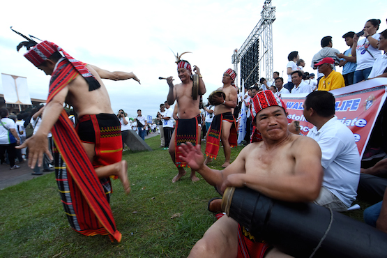 Tribal people from the northern Philippines play music at the 'Walk for Like' in Manila on Feb. 18. (Photo by Angie de Silva)