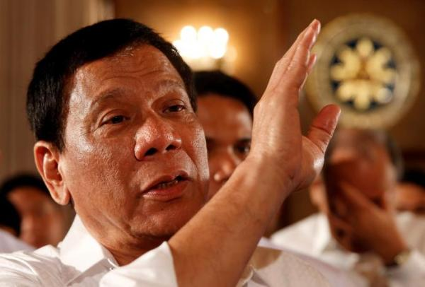 Philippine President Rodrigo Duterte talks to reporters after a news conference at the presidential palace in Manila, Philippines March 13, 2017. REUTERS/Erik De Castro