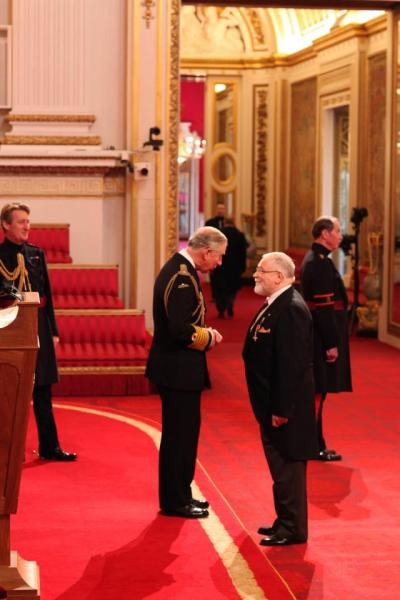 Paedophile Trevor Francis, 71, receiving his medal from Prince Charles at Buckingham Palace in 2012
