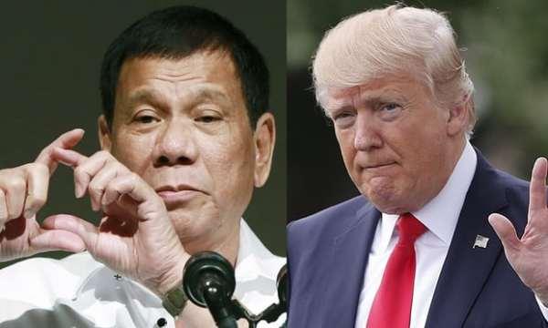 US president Donald Trump, right, has praised his Philippine counterpart, Rodrigo Duterte, left, for his 'war on drugs' that has left thousands dead. Photograph: Eugene Hoshiko, Pablo Martinez M/AP