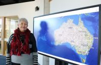 Prof Lyndall Ryan with the map, which took four years to compile