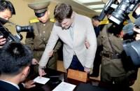 U.S. student Otto Warmbier has his fingerprints taken at North Korea's top court. KCNA / Reuters