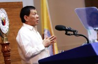 Philippine President Rodrigo Duterte threatens to close the country's Commission on Human Rights during his State of the Nation Address on July 24. (Photo by Richard Madelo)