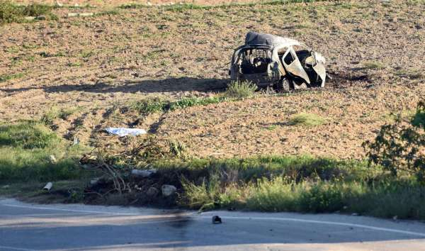 The wreckage of the car of investigative journalist Daphne Caruana Galizia lies next to a road in the town of Mosta, Malta, Monday, Oct. 16, 2017. Malta's Prime Minister Joseph Muscat said the bomb that killed reporter Daphne Caruana Galizia exploded Monday afternoon as she left her home in a town outside Malta's capital, Valetta. Rene Rossignaud/AP