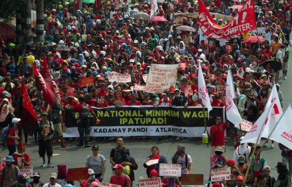 Workers call for an increase in the minimum wage in the country during May Day protest march in Manila. (Photo by Mark Saludes)