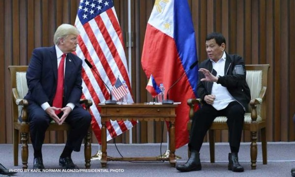 President Rodrigo Duterte (R) and U.S. President Donald Trump (L). FILE PHOTO
