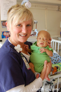 Joseph and his primary nurse, Renee', on day 100 in the NICU.