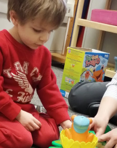 Carolyn's son plays a game during speech therapy.