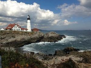 Lighthouse, rocks, sky and ocean.