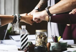 Colleagues collaborate to find the best time to relocate your business.