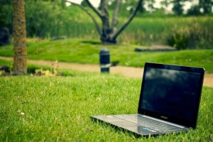 A laptop in a field of grass