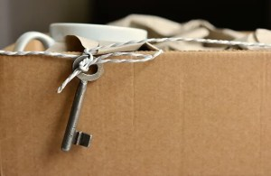 A cardboard moving box and a key
