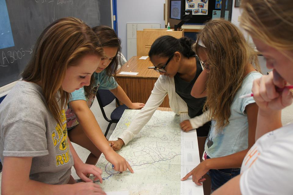 Girls looking over map
